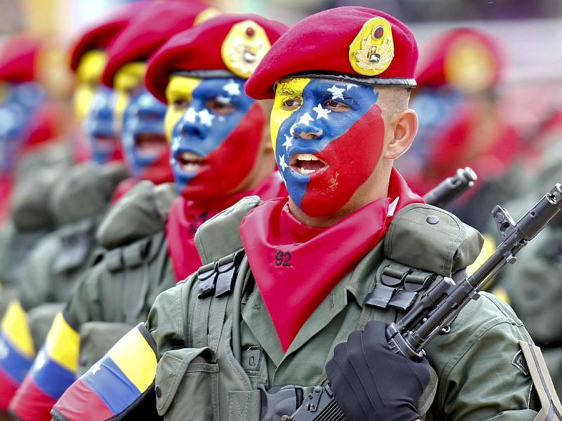 Venezuelan soldiers march during a military parade to commemorate the 20th anniversary of President Hugo Chavez's failed coup attempt in Caracas. Reuters/Jorge Silva