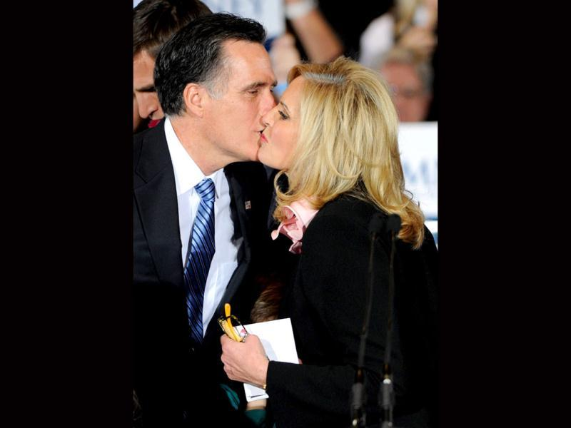 US Republican presidential candidate and former Massachusetts governor Mitt Romney (L) kisses his wife Ann Romney during an election party at the Red Rock Casino in Las Vegas, Nevada. Ethan Miller/Getty Images/AFP