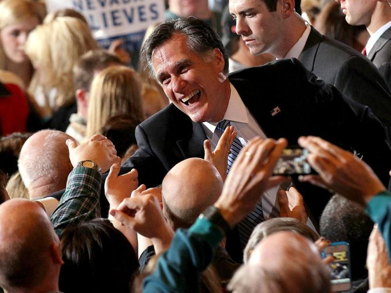 US Republican presidential candidate and former Massachusetts governor Mitt Romney greets supporters during an election party at the Red Rock Casino in Las Vegas, Nevada. Justin Sullivan/Getty Images/AFP