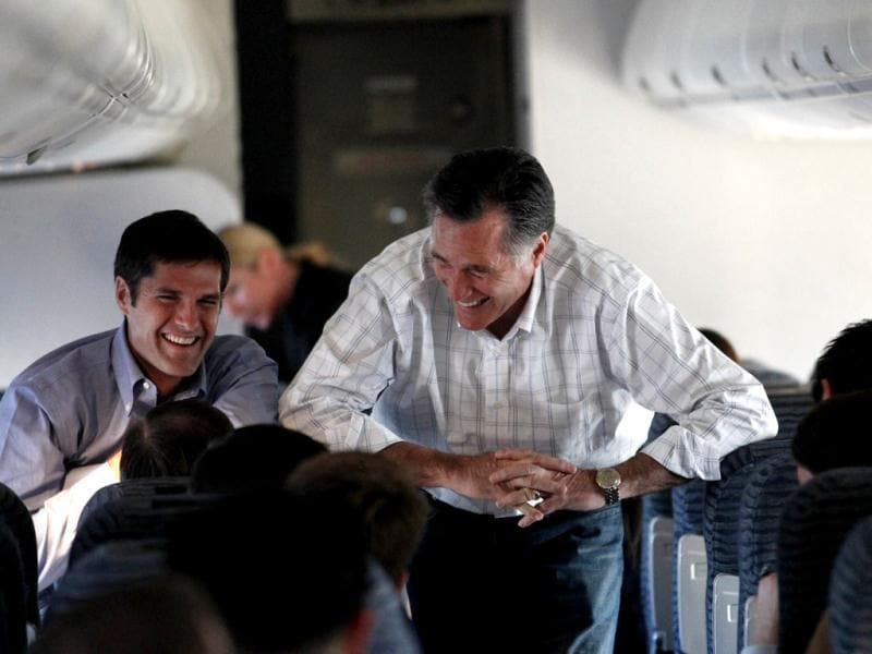 US Republican presidential candidate and former Massachusetts governor Mitt Romney talks to staff and his son Matt Romney, left, on his campaign plane en route from Colorado Springs, Colo. to Las Vegas. AP/Gerald Herbert