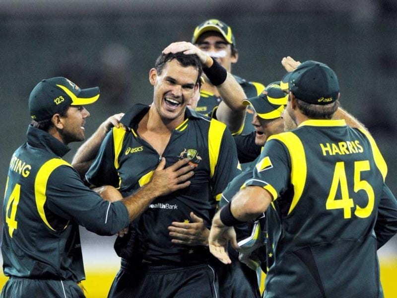 Australia's Clint McKay, center, celebrates the wicket of India's Rohit Sharma, with Ricky Ponting, left, and Ryan Harris, right, during their one day international match at the MCG in Melbourne, Australia.(AP Photo/Mal Fairclough)