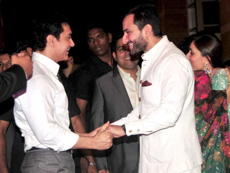 Actors Aamir and Saif Ali Khan seem quite happy to see each other. (HT Photo: Amlan Datta)