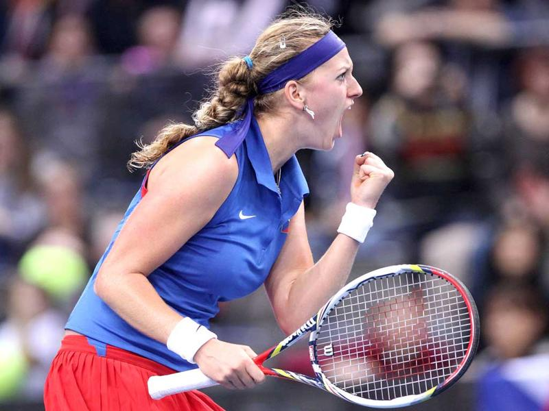 Petra Kvitova from the Czech Republic reacts during the FedCup World Group tennis match against Sabine Lisicki between Germany and the Czech Republic in Stuttgart, southern Germany. AFP PHOTO/Daniel Roland
