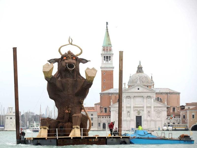 A sculpture of bull, symbolising the 2012 Venice carnival and inspired by ancient rites of the Venetian lagoon, is carried on the boat in front of St Mark's square in Venice. AFP photo