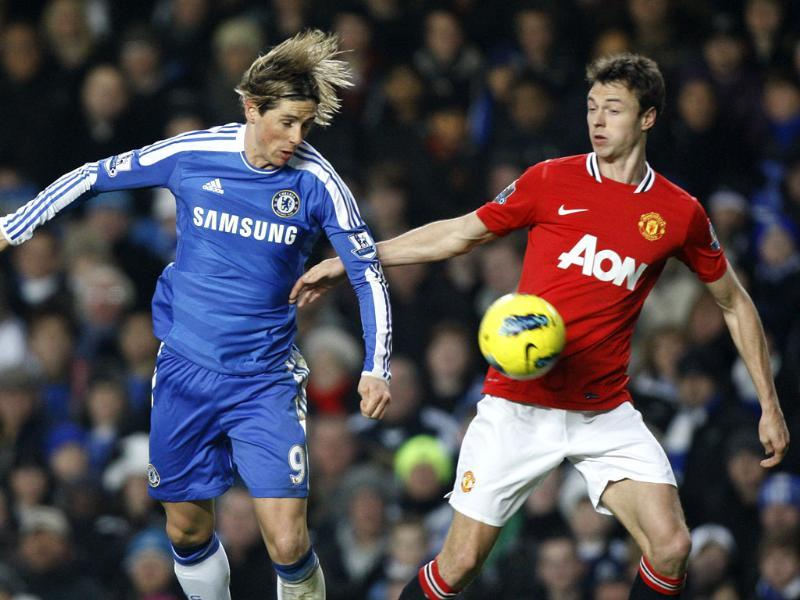 Chelsea's Fernando Torres (L) vies for the ball with Manchester United's Jonny Evans during their English Premier League soccer match at Chelsea's Stamford Bridge Stadium in London. AP Photo/Kirsty Wigglesworth