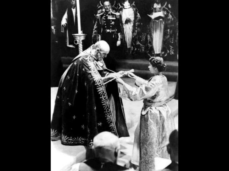 The Archbishop of Canterbury gives the Queen Elizabeth II a sword, prior to the Coronation ceremony, 02 June 1953 in Westminster Abbey. FileAFP Photo