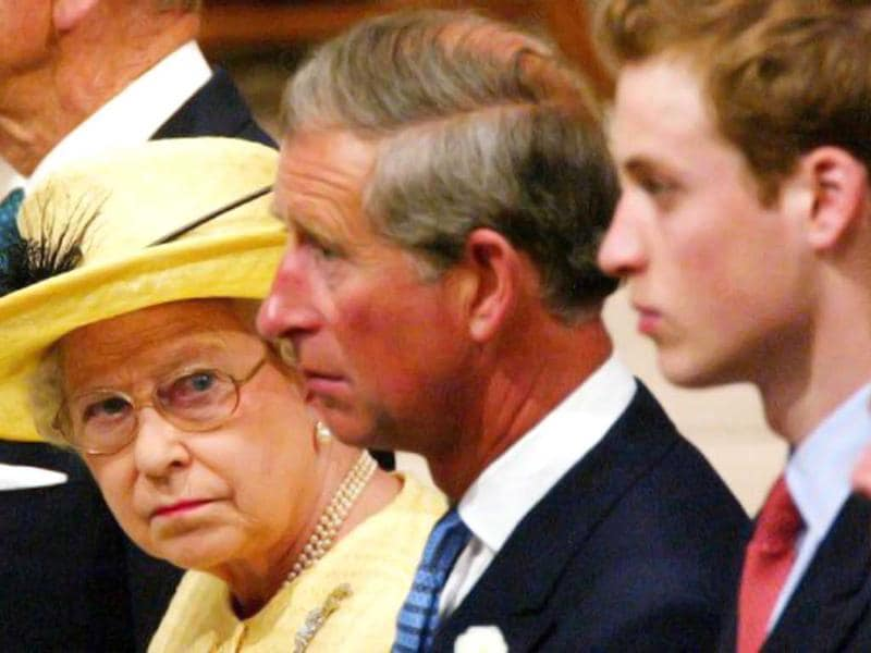 Queen Elizabeth II looks across to first in line for the throne, Prince Charles (C) and 2nd in line Prince William (R) during the ceremony marking the 50th anniversary of her coronation at Westminster Abbey in London 02 June 2003. File Photo. AFP Photo