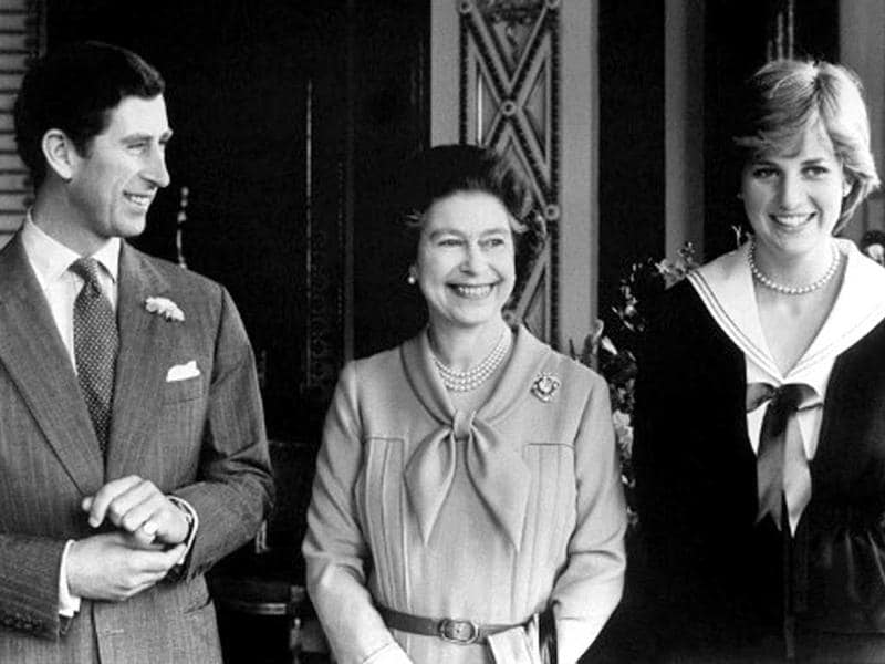 Queen Elizabeth II is accompanied by her son Prince Charles and Lady Diana, 27 March 1981 at Buckingham Palace in London - File. AFP Photo