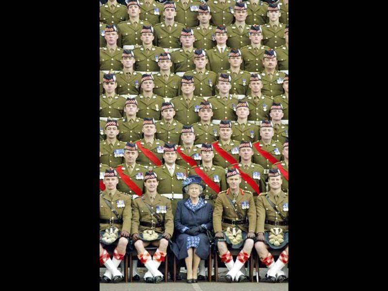 Britain's Queen Elizabeth II poses for a picture 09 November, 2004 with members of the 1st Battalion of the Argyll and Sutherland Highlanders at Howe Barracks in Kent, England - File. AFP Photo