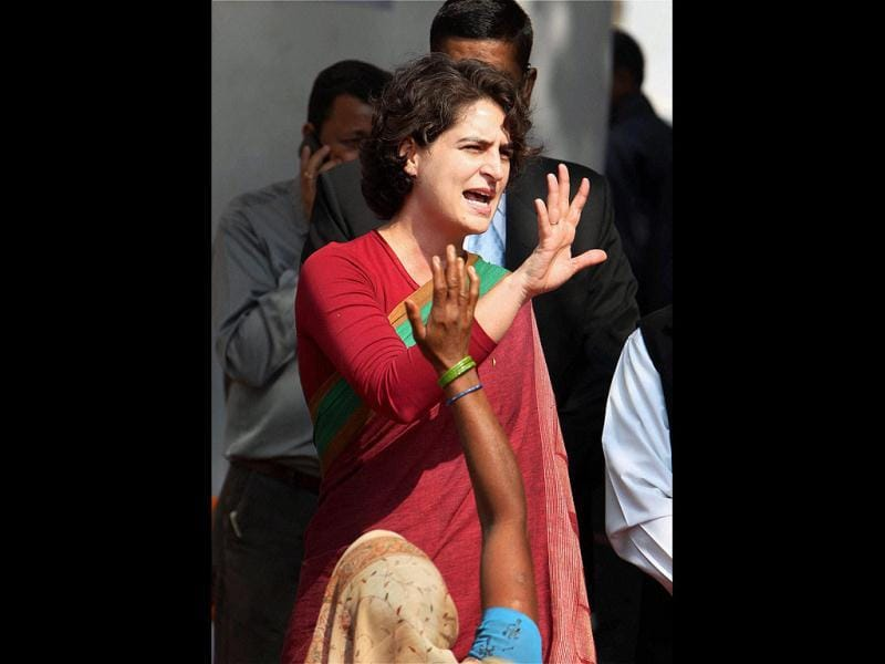 Congress party campaigner Priyanka Gandhi Vadra interacts with voters at a meeting at Bhusiyawa in Amethi. PTI Photo/Atul Yadav