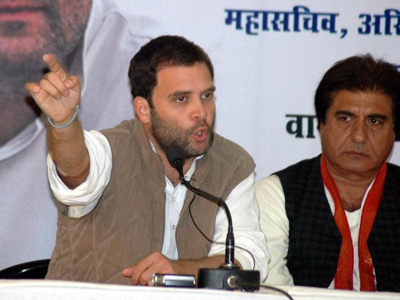Congress general secretary Rahul Gandhi with party MP Raj Babbar addressing a press conference in Varanasi. Agencies