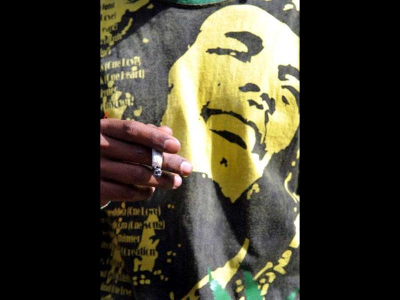 A man wearing a T-shirt of Jamaican musician Bob Marley during the International Day for the Legalization of Marijuana in Medellin, Antioquia Department, Colombia. (AFP Photo)