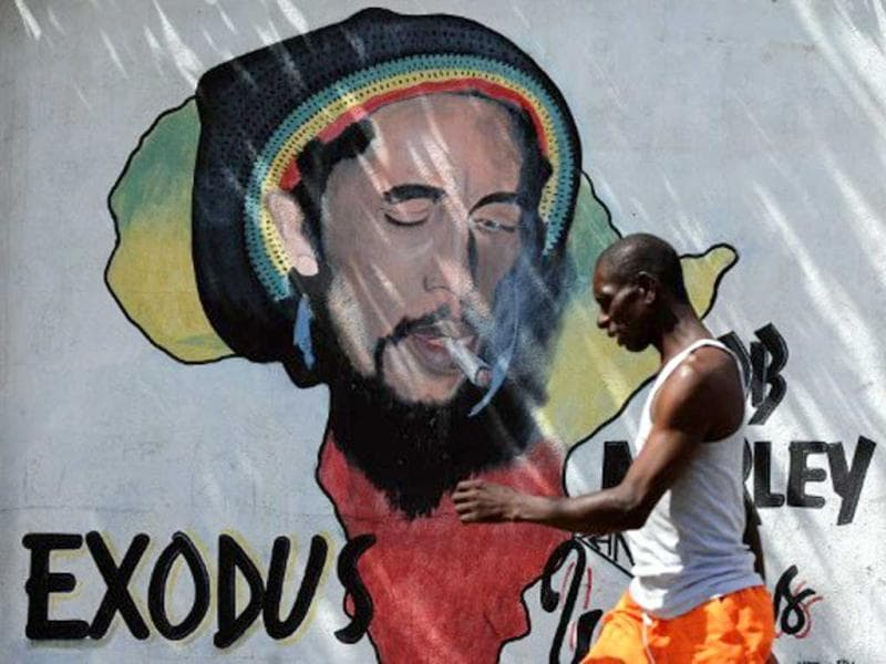 A man walks past a mural of late musician Bob Marley in Kingston. Marley, who was born in 1945 and died in 1981, remains the most widely known and revered performer of reggae music and is also credited for helping spread Jamaican music to a worldwide audience. (AFP Photo)