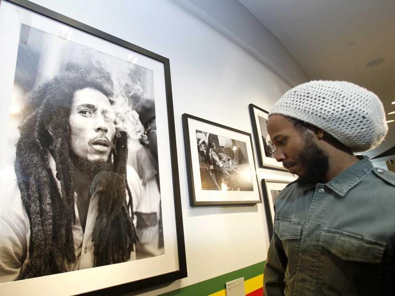 Jamaican musician David 'Ziggy' Marley looks at photographs of his father on display on the opening day of the exhibit