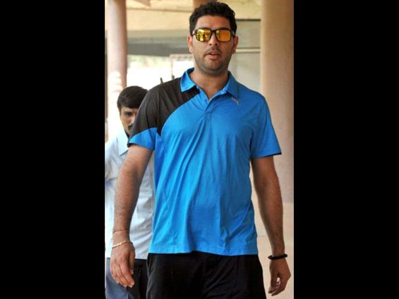 Yuvraj Singh: The news of a malignant tumour, which was was revealed on Februrary 5, 2012, between his lungs shocked the all rounder's friends and fans. The player is currently undergoing treatment in the US and will be able to resume training in May, his doctor said. (File photo: AFP)