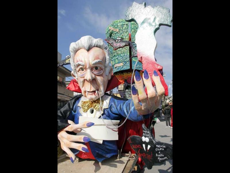 A carnival float showing Italian prime minister Mario Monti as a vampire parades during the carnival in Viareggio . AFP PHOTO/Fabio Muzzi