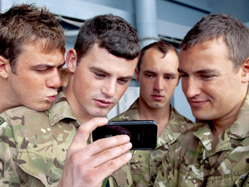 British Royal Marines Commando watch a video during Operation Bold Alligator 2012, a multinational military exercise involving 14,000 Marines, Sailors, Airmen, and Soldiers with more than 25 ships and 8 countries. AFP/Paul J. Richards