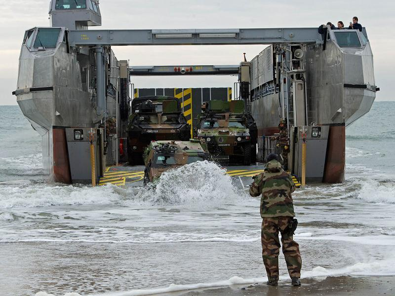 French equipment and troops come ashore via the new LCAT, a large transport catamaran during Operation Bold Alligator 2012, a multinational military exercise involving 14,000 Marines, Sailors, Airmen, and Soldiers with more than 25 ships and 8 countries. AFP Photo/Paul J. Richards