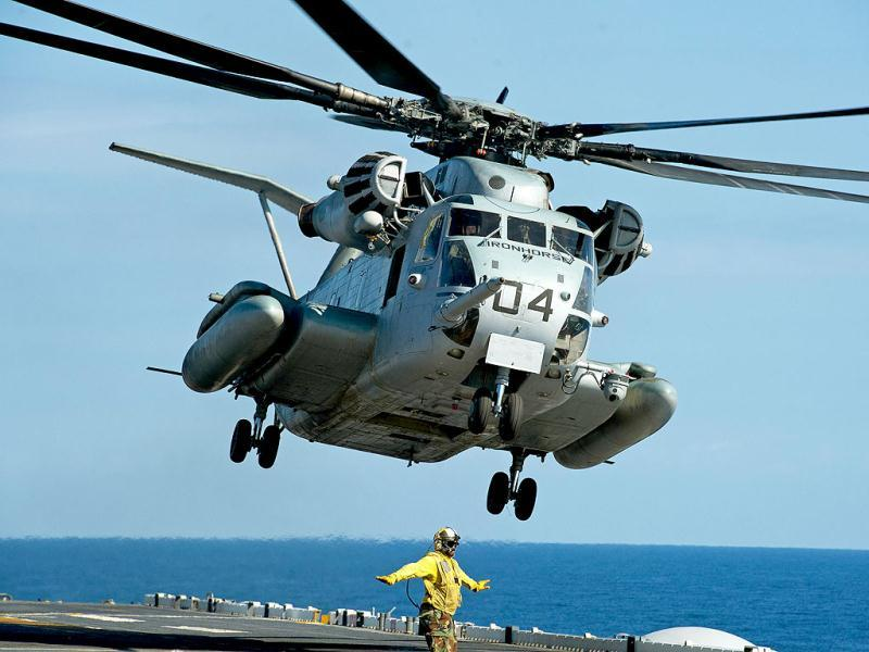 A Sikorsky CH-53E Super Stallion Iron Horse helo takes off from the deck of the USS Wasp (LHD-1) during Operation Bold Alligator 2012, a multinational exercise involving 14,000 Marines, Sailors, Airmen, and Soldiers with more than 25 ships and 8 countries. AFP/Paul J.