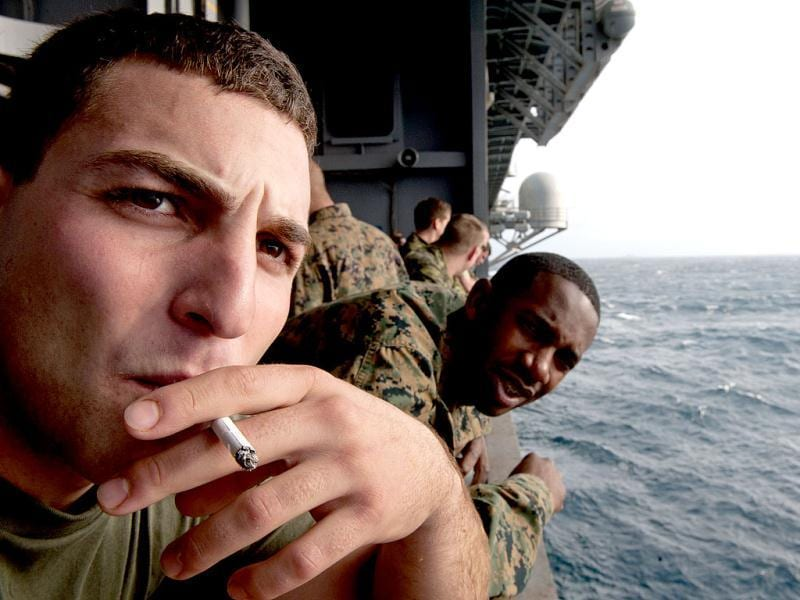 US Marine Lance Cpl. Joseph Lipton, from Summers, CT, takes a cigarette break on the side of the USS Wasp (LHD-1) during Operation Bold Alligator 2012. AFP/Paul J. Richards