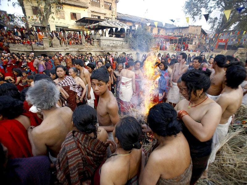 Devotees warm themselves by a fire after taking a dip on the final day of the month-long Swasthani festival in the Hanumante River at Bhaktapur, near Kathmandu. The month-long festival, dedicated to God Madhavnarayan and Goddess Swasthani, involves the recitation of folk tales about miraculous feats performed by them in many households. Reuters Photo/Navesh Chitrakar