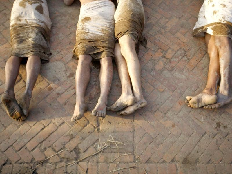 The feet of devotees are pictured while as they offer prayers by rolling on the street of Bhaktapur, near Kathmandu. The month-long Swasthani festival, dedicated to God Madhavnarayan and Goddess Swasthani, involves the recitation of folk tales about miraculous feats performed by them in many households. Reuters Photo/Navesh Chitrakar