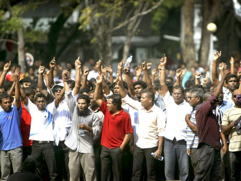 Opposition supporters stage a protest at the Republican Square in Male, Maldives. Maldives President Mohamed Nasheed announced his resignation today following weeks of public protests over his controversial order to arrest a senior judge. (AP Photo/Sinan Hussain)