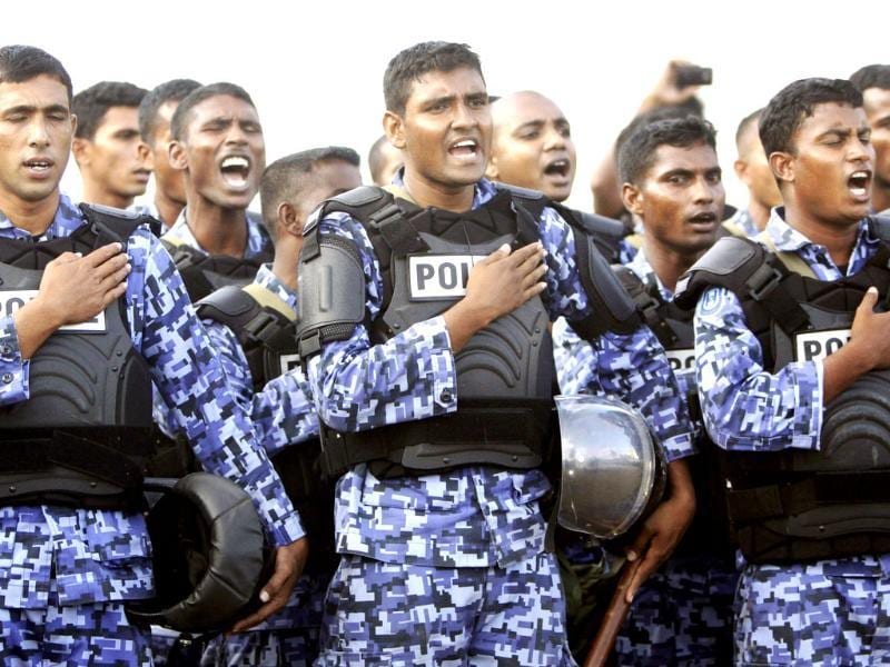 Maldives police officers assume taking an oath before joining a protest against the military in Male, Maldives. Maldives President Mohamed Nasheed announced his resignation today following weeks of public protests over his controversial order to arrest a senior judge. (AP Photo/Sinan Hussain)