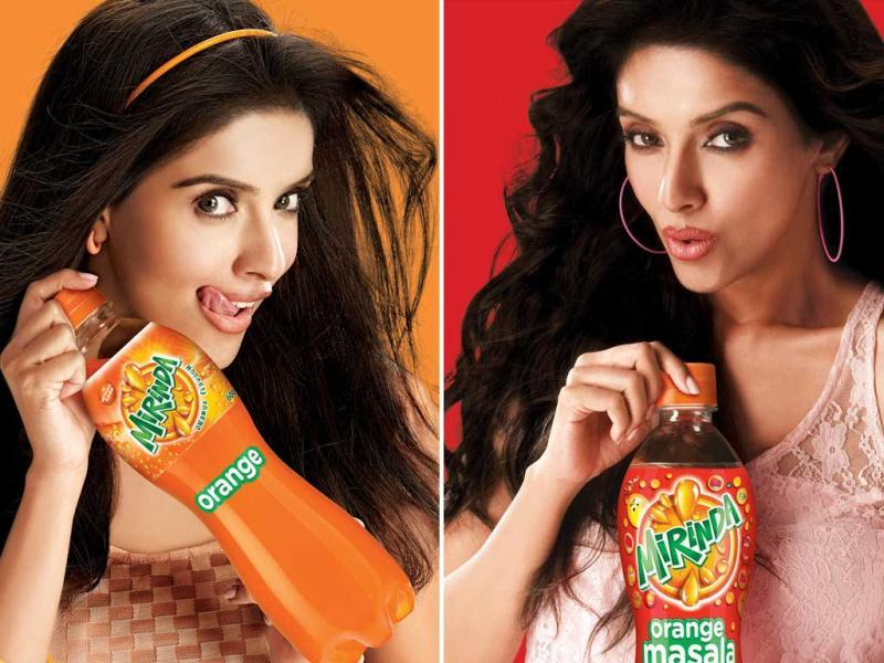 Ghajini actor Asin oozed oomph in Mirinda's latest campaign as she dons three different avatars for the soft drink brand. Check her out.