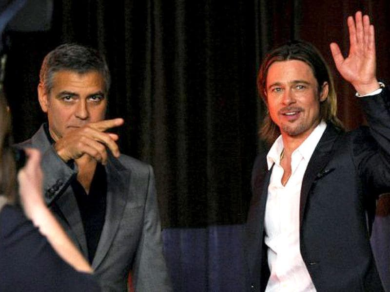 Competitors George Clooney and Brad Pitt clearly look up to no good.