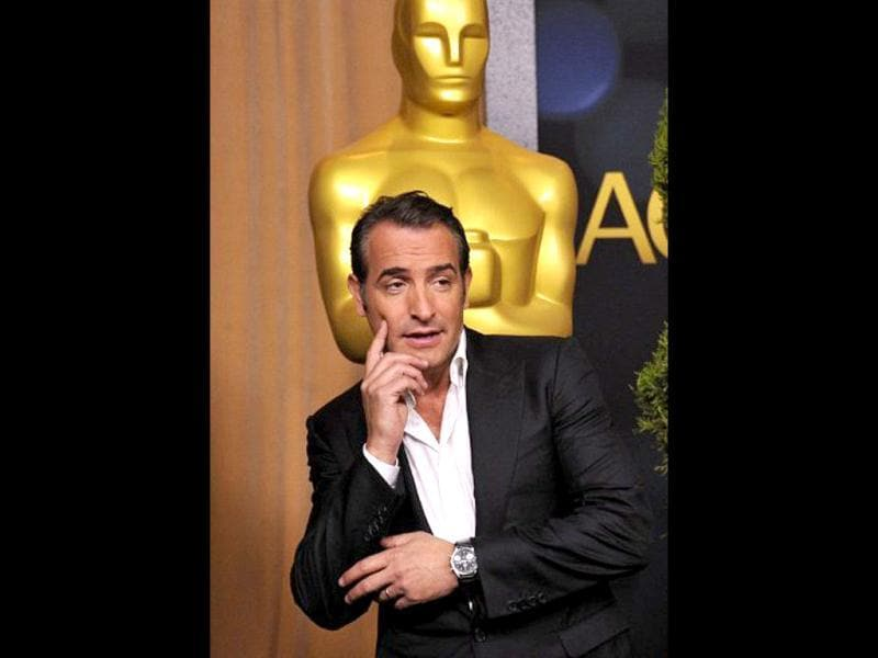 The Artist actor Jean Dujardin strikes a pose as he looks dapper as ever.