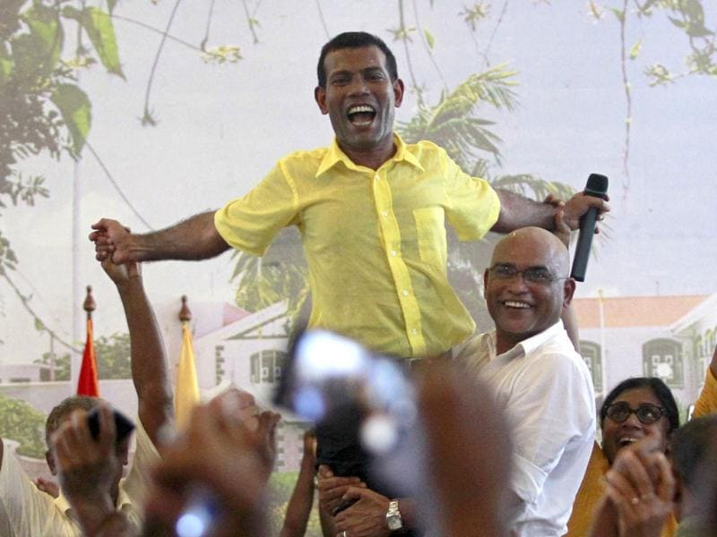 Ousted Maldivian President Mohamed Nasheed is carried by his supporters during the Maldivian Democratic Party's meeting in Male. Reuters photo