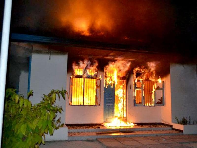 A burning police station in the city of Addu, the second largest city of the Maldives. AFP photo