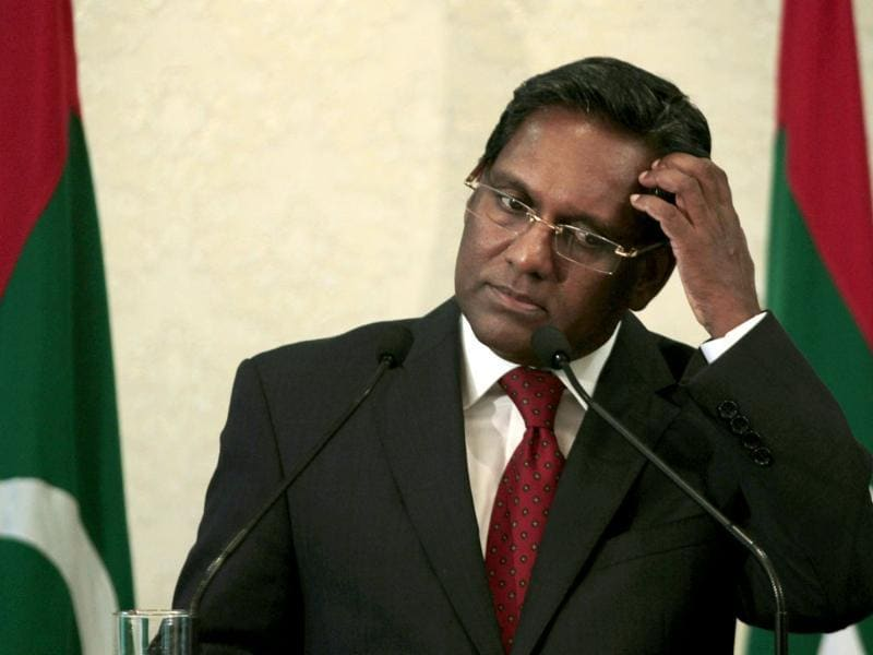 Maldives' newly elected President Mohammed Waheed Hassan gestures during a press conference in Male. AP photo