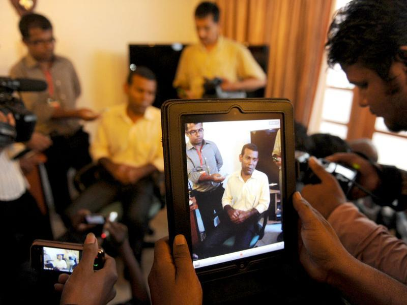 Former Maldivian President Mohamed Nasheed is pictured on a screen as he speaks to reporters at his residence in the capital island Male. AFP photo