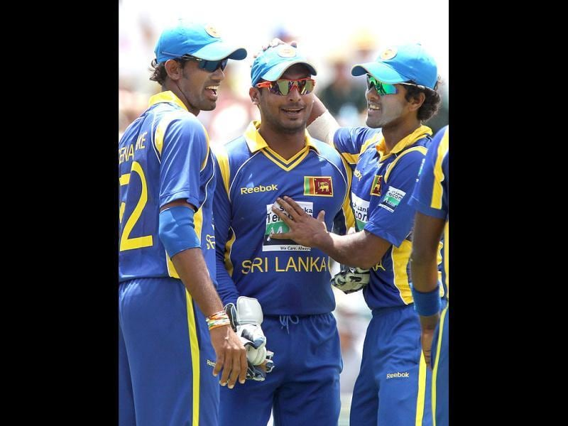 Kumar Sangakkara is congratulated by team mates for catching out Matthew Wade during the match against Australia in the Tri Nations ODI Series at the WACA ground in Perth. AFP