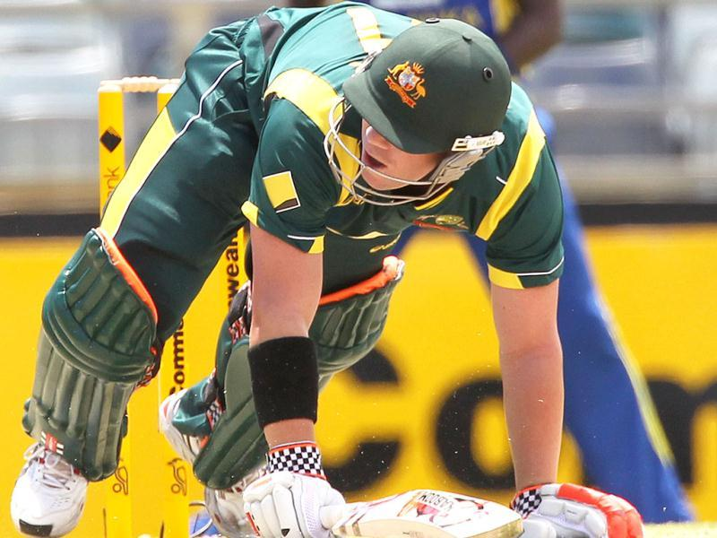 David Warner slips as he digs out a yorker during the match against Sri Lanka in the Tri Nations ODI Series at the WACA ground in Perth. AFP
