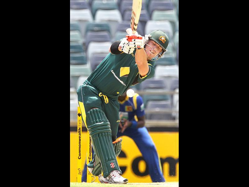 David Warner drives a ball during the Tri Nations ODI Series match between Australia and Sri Lanka at the WACA ground in Perth. AFP