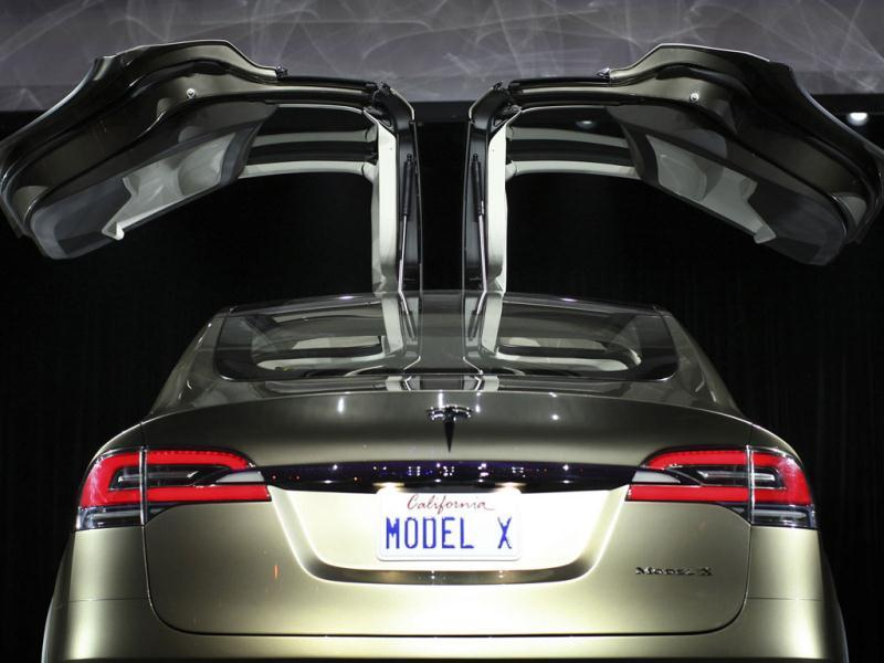 The falcon wing rear doors of the Tesla Motors Model X electric vehicle are seen at its unveiling at the Tesla Design Studio in Hawthorne, California February 9, 2012. Reuters photo/David McNew