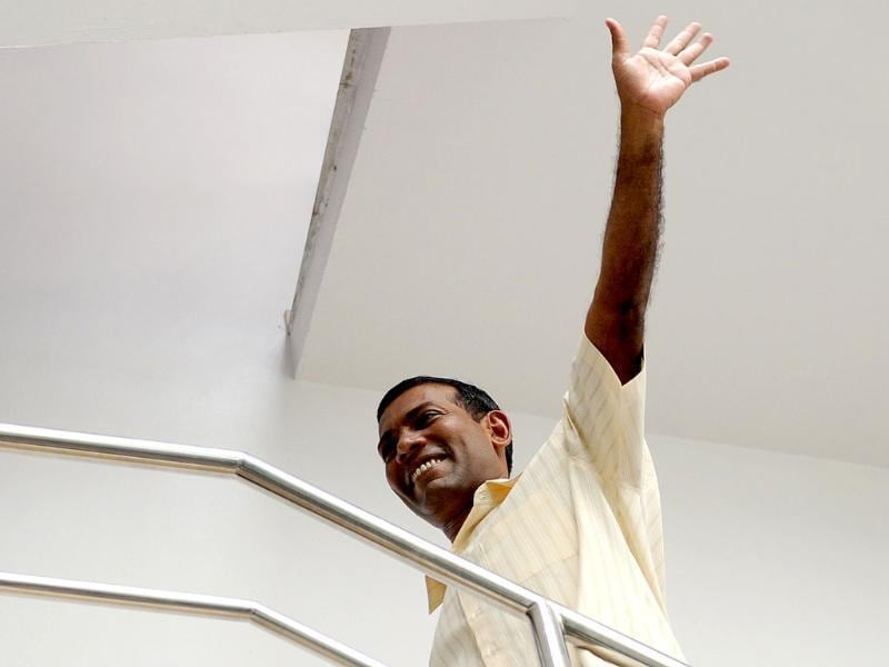 Former Maldives president Mohamed Nasheed waves after Friday prays at his home in Male. AFP photo