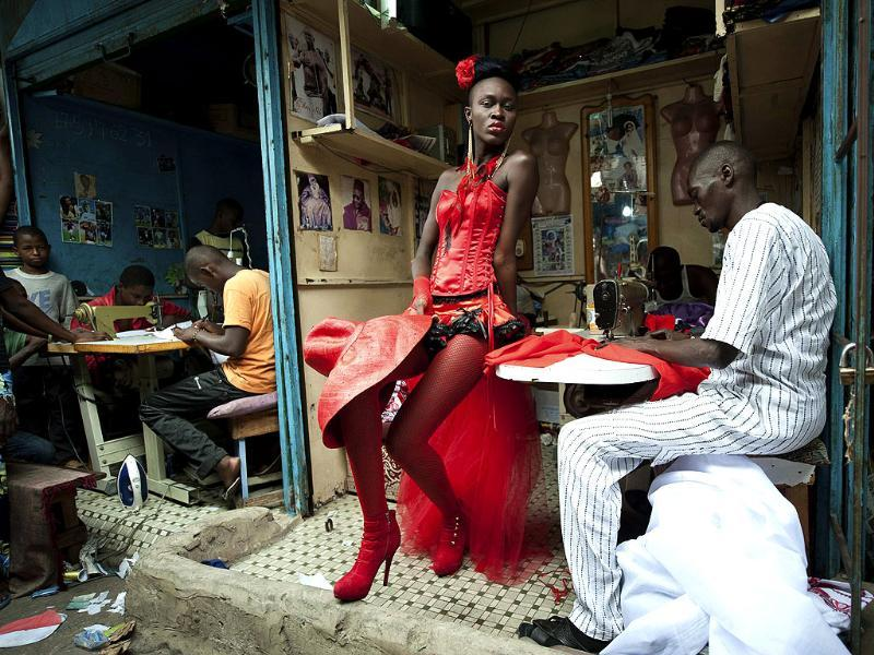 Vincent Boisot of France, a Riva Press photographer working for Le Figaro Magazine, has won the second prize Arts and Entertainment Singles with this picture of a model posing in front of tailor stalls in the center of Dakar, Senegal. REUTERS/Vincent Boisot