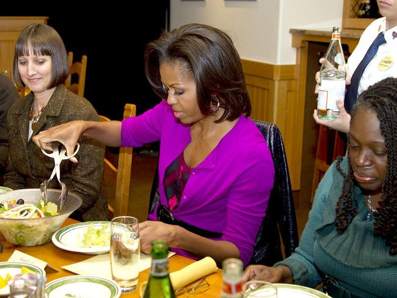 US First lady Michelle Obama serves herself some salad during a roundtable dinner at an Olive Garden restaurant in Fort Worth, Texas, during her three day national tour celebrating the second anniversary of Let's Move. AP/Carolyn Kaster