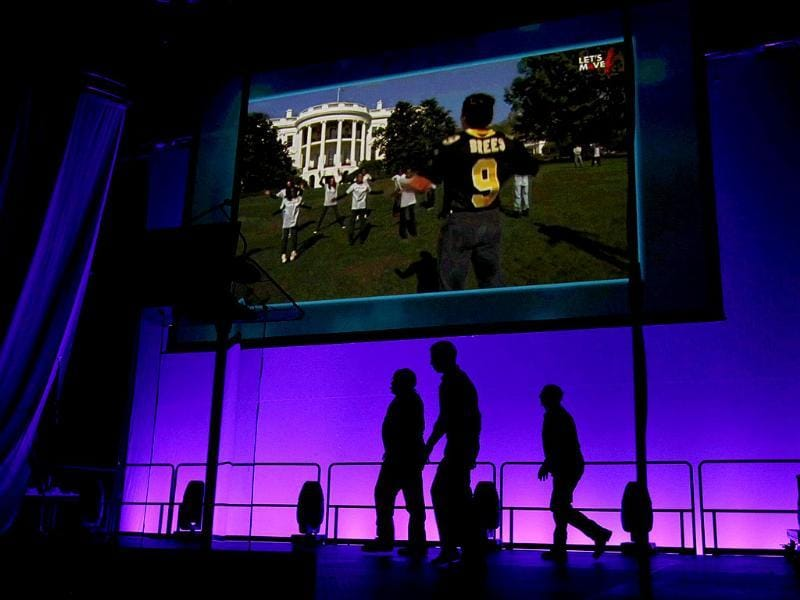 A video promoting US First lady Michelle Obama's Let's Move initiative plays on a big screen as stage hands prepare for her arrival to speak to youths at the Wells Fargo Arena in Des Moines. Reuters/Kevin Lamarque
