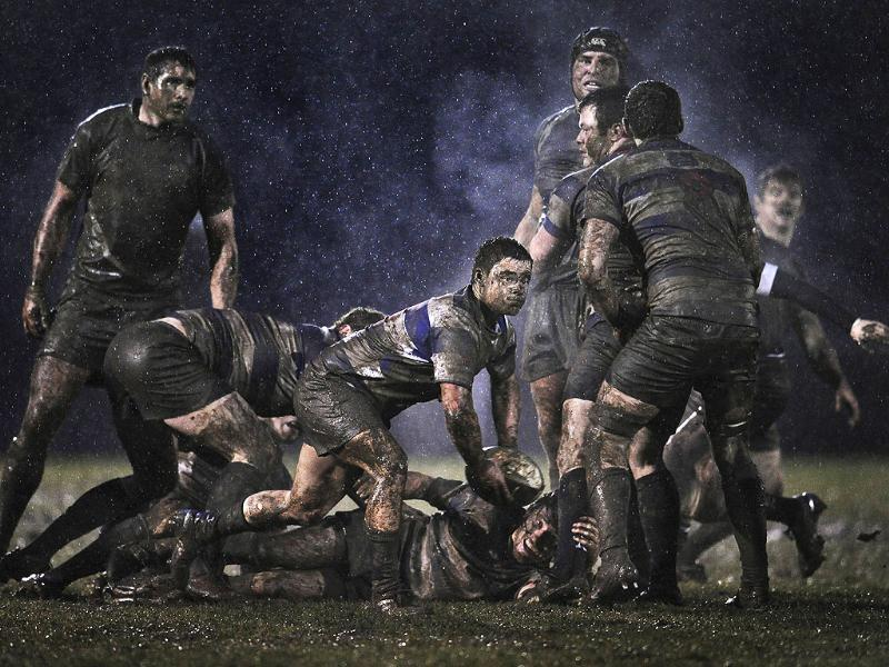Ray McManus of Ireland, a photographer working for Sportsfile, has won the second prize Sports Singles with this action picture from a rugby match between Old Belvedere and Blackrock played in heavy rain in Dublin, Ireland. REUTERS/Ray McManus