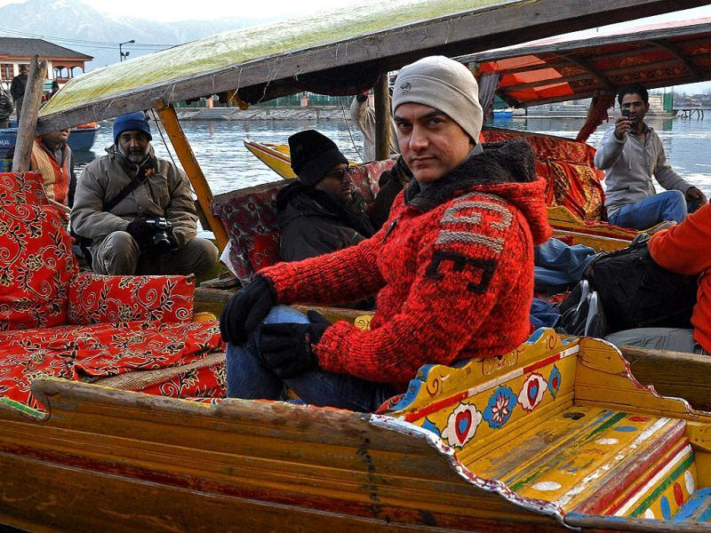 Bollywood actor Aamir Khan rides in a 'shikara', a Kashmiri boat, during his visit to Srinagar on Thursday to explore shooting locations. Check out the pics.