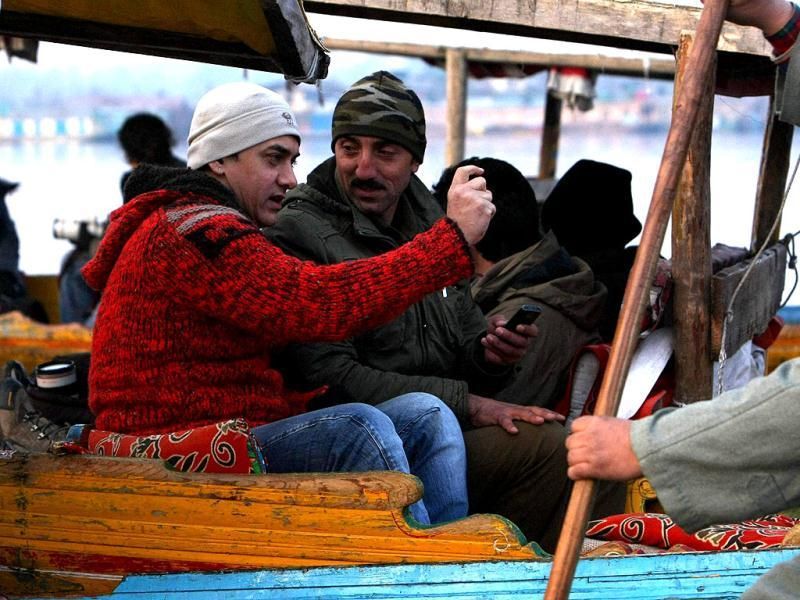 Aamir Khan rides in a 'shikara', a Kashmiri boat, during his visit to Srinagar on Thursday to explore shooting locations.