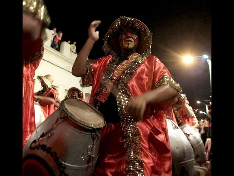 Members of a comparsa, an Uruguayan carnival band, play the drums to perform candombe music and dance during the first night of the Llamadas parade in Montevideo . The Llamadas, which is Spanish for