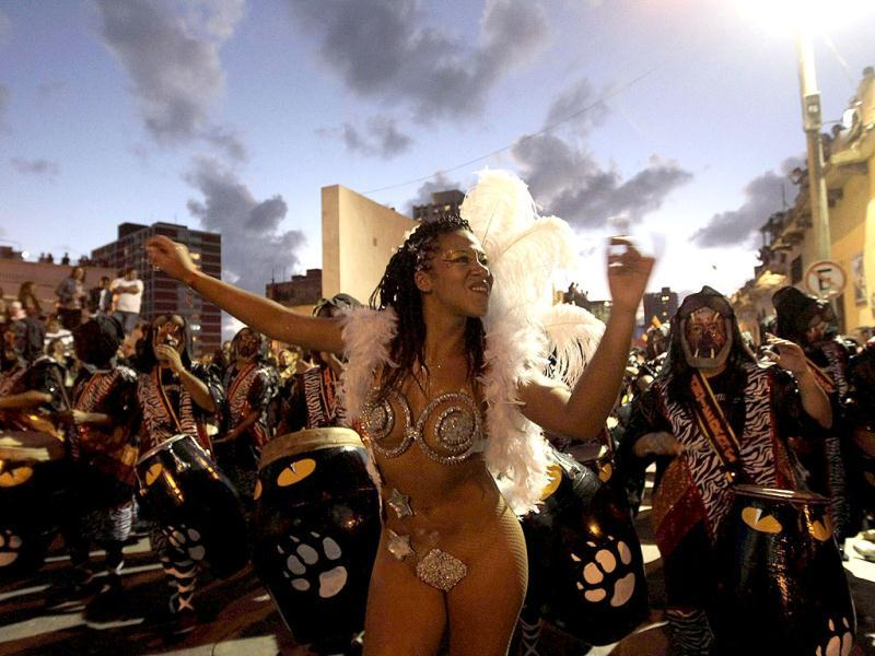 Members of a comparsa, an Uruguayan carnival band, plays the drums to perform candombe music and dance during the first night of the Llamadas parade in Montevideo. The Llamadas, which is Spanish for