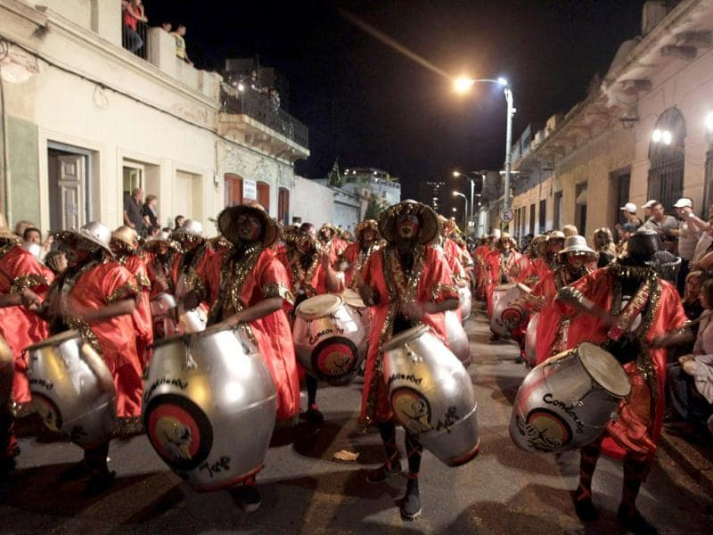 Members of a comparsa, an Uruguayan carnival band, play the drums to perform candombe music and dance during the first night of the Llamadas parade in Montevideo. The Llamadas, which is Spanish for