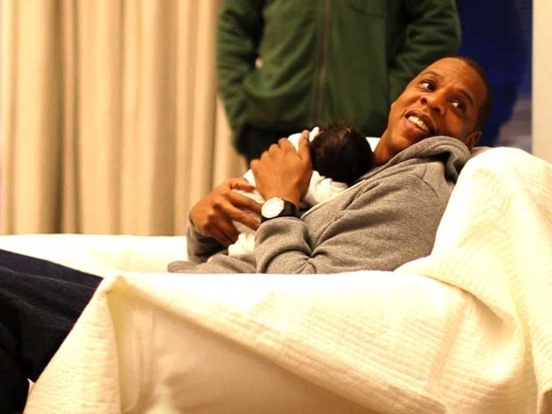 Jay-Z cuddles with daughter Blue Ivy.